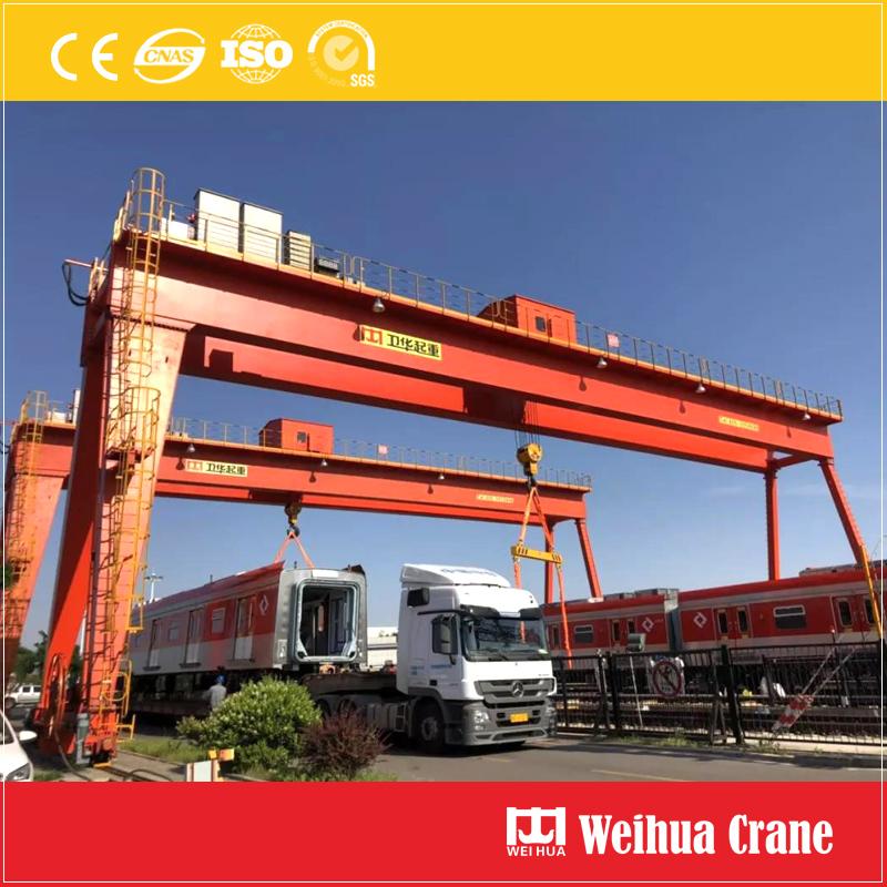 2-gantry-cranes-lifting-train